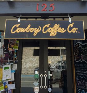 Exterior image of Cowboy Coffee Company cafe in Jackson, WY, doors and signage